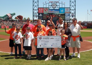 Check Presentation at the San Francisco Giants Junior Giants Glove Drive/Equipment Day Collection