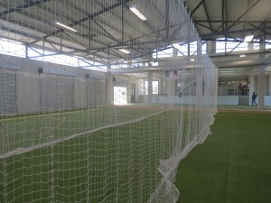 The South Africa Baseball Union indoor facility - partially funded with a BTF grant - divides  the space using drop down netting.